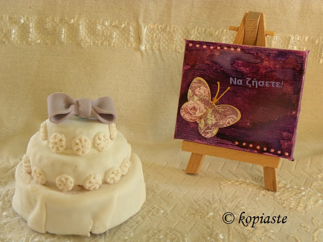 Mini wedding cake with purple painting