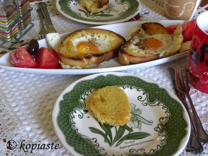 Brunch bread eggs tomatos olives feta